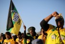 Supporters of the African National Congress hold the party flag during ANC president Jacob Zuma's election campaign in Atteridgeville a township located to the west of Pretoria, South Africa July 5, 2016. REUTERS/Siphiwe Sibeko - RTX2JTT6