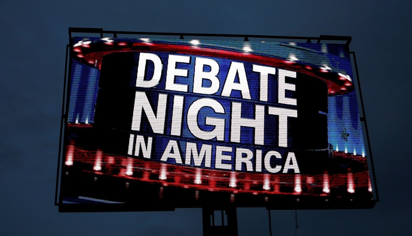 A projection screen is seen outside Hofstra University, the site of the September 26 first presidential debate between U.S. Republican nominee Donald Trump and Democratic presidential nominee Hillary Clinton, in Hempstead, New York, U.S., September 26, 2016.   REUTERS/Shannon Stapleton - RTSPJZ7