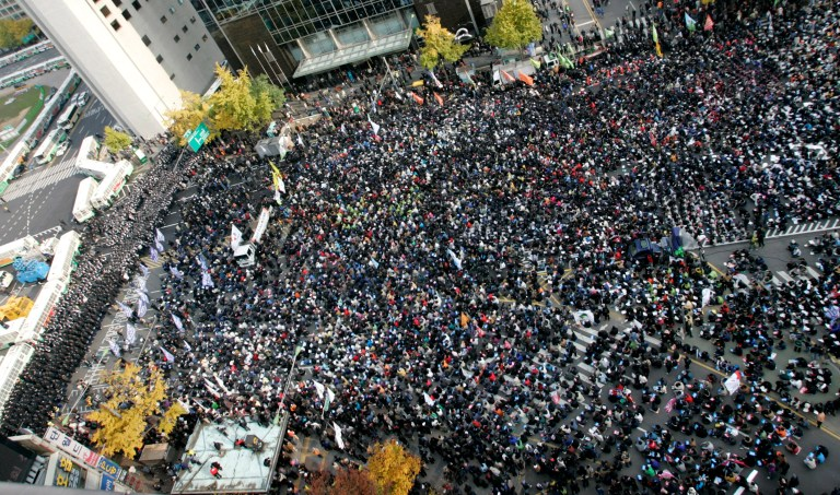 Protesters take part in a rally against the South Korea-U.S. free trade agreement talks in Seoul. REUTERS/Han Jae-Ho.