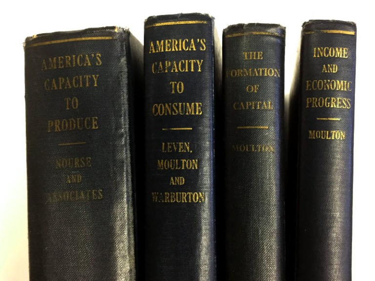 Picture of the spines of the four volumes in the capacity studies