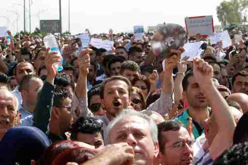 Protesters, who are mostly school teachers, demonstrate on a street in Sulaymaniyah province, Iraq, against the Kurdish regional government