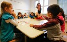 A teacher conducts a German lesson for children of a welcome class for immigrants at the Katharina-Heinroth primary school in Berlin, Germany, September 11, 2015. REUTERS/Fabrizio Bensch - RTSM05
