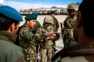 U.S. soldiers from the 3rd Cavalry Regiment speak with Afghan National Army soldiers about their logistics while on an advising mission at the Afghan National Army headquarters for the 203rd Corps in the Paktia province of Afghanistan December 21, 2014. REUTERS/Lucas Jackson (AFGHANISTAN - Tags: CIVIL UNREST POLITICS MILITARY) - RTR4IUML