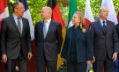 U.S. Secretary of State Clinton and foreign ministers take a group photo during G-8 Foreign Ministers Meeting in Washington
