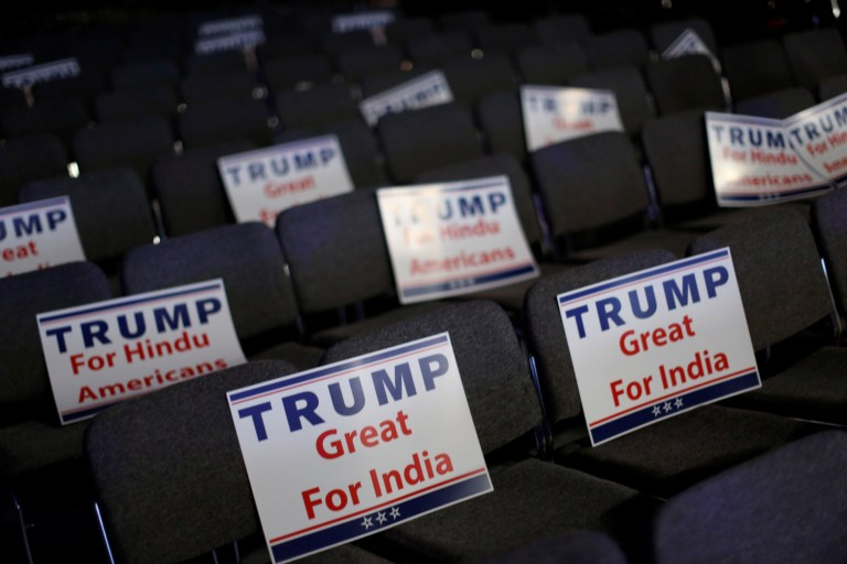 Signs are ready for attendees to hold during Republican presidential nominee Donald Trump's remarks at a Bollywood-themed charity concert put on by the Republican Hindu Coalition in Edison, New Jersey, U.S. October 15, 2016. REUTERS/Jonathan Ernst - RTX2P03T
