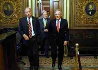 U.S. Senator Dan Coats (R-IN) (L-R), Senator Lamar Alexander (R-TN) and Senate Minority Leader Mitch McConnell (R-KY) depart following their weekly Republican caucus lunch meeting