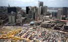 An aerial view shows the central business district in Nigeria's commercial capital of Lagos, April 7, 2009. Nigeria's First Bank and Access Bank on Wednesday became two of a handful of Nigerian financial institutions to adopt international reporting standards, seen as key to restoring confidence in the battered sector. REUTERS/Akintunde Akinleye (NIGERIA CITYSCAPE BUSINESS POLITICS) FOR BEST QUALITY IMAGE SEE: GM1E83L1P8V01 - RTXDQV5
