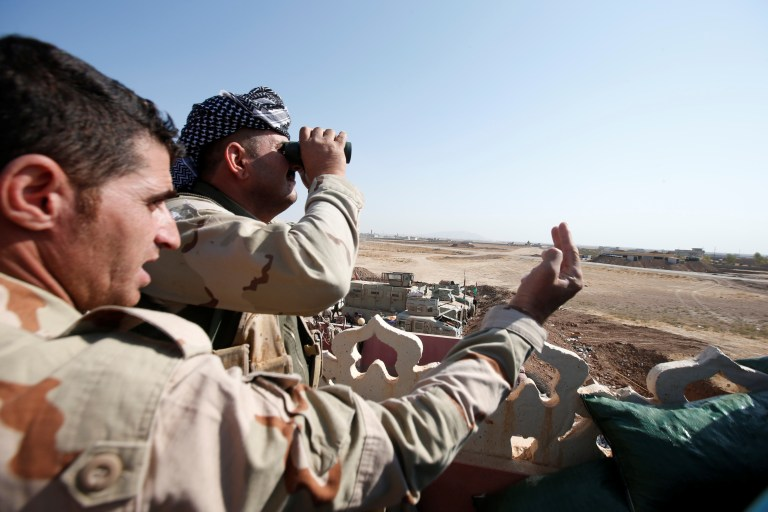 A member of Peshmerga forces looks through a pair of binoculars on the outskirts of Bashiqa, east of Mosul, during an operation to attack Islamic State militants in Mosul, Iraq, October 30, 2016. REUTERS/Azad Lashkari - RTX2R36M