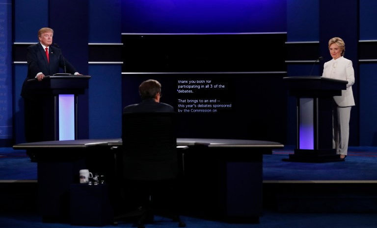 A teleprompter in front of moderator by Chris Wallace (C) marks the end of the third and final 2016 presidential campaign debate between Republican U.S. presidential nominee Donald Trump and Democratic U.S. presidential nominee Hillary Clinton at UNLV in Las Vegas, Nevada, U.S., October 19, 2016. REUTERS/Mike Blake - RTX2PMA9