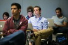 Students listen to a presentation while in class at Stanford University.,