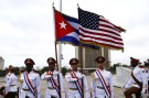 Honor guards carry the U.S. and Cuban flags during a wreath laying ceremony by U.S. President Barack Obama at the Jose Marti monument in Revolution Square in Havana, Cuba March 21, 2016. REUTERS/Ivan Alvarado - RTSBK5C
