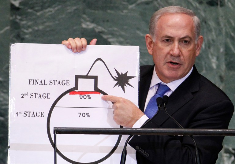 Israel's Prime Minister Benjamin Netanyahu points to a red line he drew on the graphic of a bomb used to represent Iran's nuclear program as he addresses the 67th United Nations General Assembly at the U.N. Headquarters in New York, September 27, 2012. The red line represents a point where he believes the international community should tell Iran that they will not be allowed to pass without intervention. REUTERS/Lucas Jackson (UNITED STATES - Tags: POLITICS) - RTR38I79