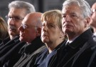 German President Joachim Gauck, Chancellor Angela Merkel and Norbert Lammert, President of Germany's lower house of parliament Bundestag (from R) attend a service at Berlin's Memorial church (Gedaechtniskirche) to commemorate the 12 killed victims of a truck that ploughed into a crowded Christmas market at Breitscheidplatz in Berlin, Germany, December 20, 2016. REUTERS/Michael Kappeler/Pool