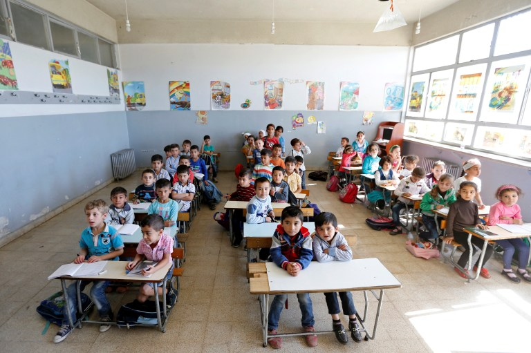Syrian refugee children attend a class at a school in Mount Lebanon, October 7, 2016. REUTERS/Mohamed Azakir - RTSR7GP