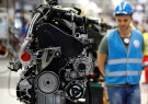 Workers work on a new Volkswagen Crafter diesel engine