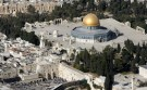 An aerial view shows the Dome of the Rock (R) on the compound known to Muslims as the Noble Sanctuary and to Jews as Temple Mount, and the Western Wall (L) in Jerusalem's Old City.