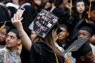 A graduating student of the City College of New York takes a selfie of the message on her cap during the College's commencement ceremony in the Harlem section of Manhattan, New York, U.S., June 3, 2016. REUTERS/Mike Segar     TPX IMAGES OF THE DAY      - RTX2FKQ6