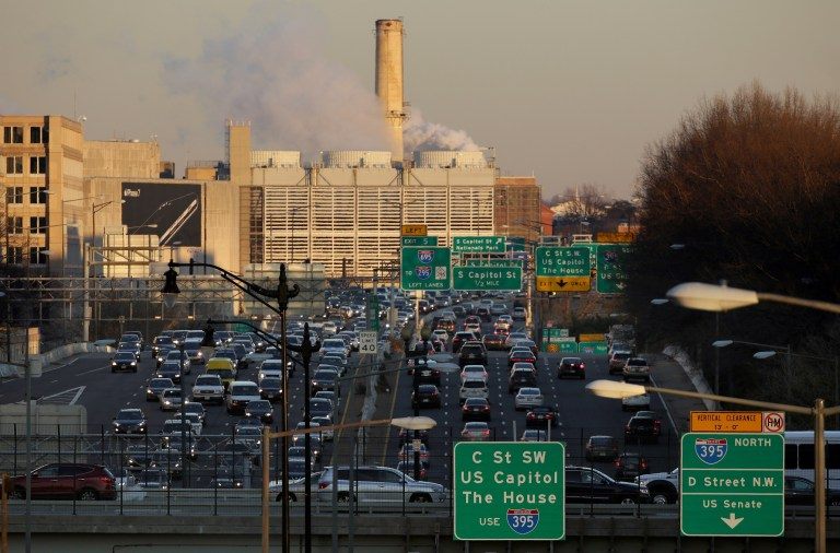 Steam vents from the Capitol Power Plant as rush-hour traffic passes through Washington, U.S., December 20, 2016. REUTERS/Joshua Roberts - RTX2VXTL