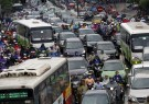 Commuters are seen during rush hour on a street in Hanoi, Vietnam