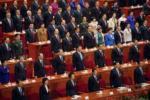 President Xi Jinping (2nd row, 5th L), Premier Li Keqiang (2nd row, 6th L) and other Chinese leaders sing China's national anthem during the closing ceremony of National People's Congress (NPC) at the Great Hall of the People in Beijing, China, March 16, 2016. REUTERS/Damir Sagolj - RTSAMOJ