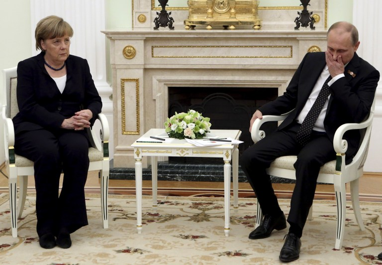 Russian President Vladimir Putin (R) meets with German Chancellor Angela Merkel at the Kremlin in Moscow, Russia, in this May 10, 2015 file photo. To match Insight GERMANY RUSSIA/RELATIONS REUTERS/Sergei Karpukhin/Files TPX IMAGES OF THE DAY - RTSDG7J