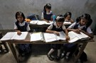 Schoolchildren study inside their classroom at a government-run school in Kolkata