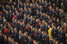 Delegates sing China's national anthem during the closing ceremony of China's National People's Congress at the Great Hall of the People in Beijing