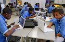 Students at the Lilla G. Frederick Pilot Middle School work on their laptops during a class in Dorchester, Massachusetts June 20, 2008.