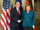 German Chancellor Angela Merkel poses for a picture with U.S. Vice President Mike Pence before their meeting at the 53rd Munich Security Conference in Munich, Germany, February 18, 2017. REUTERS/Michael Dalder - RTSZ8P4