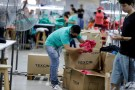 Paraguayan workers assemble clothes for Brazilian retailer Riachuelo at the factory of Texcin in Limpio, Paraguay December 20, 2016. REUTERS/Jorge Adorno - RTS1084C