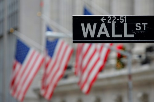 A street sign for Wall Street is seen outside the New York Stock Exchange (NYSE) in Manhattan, New York City, U.S. December 28, 2016. REUTERS/Andrew Kelly - RTX2WRNR
