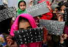 Kashmiri school girls show their blackboards at an outdoor school in the mountainous village of Dhatura in the Neelum Valley, north of the earthquake-devastated city of Muzaffarabad, in Pakistan-administered Kashmir February 21, 2006. Winter weather has made life more difficult for survivors of last year massive earthquake in South Asia where more than two million people have been living in tents or crude shelters patched together from ruined homes. REUTERS/Thierry Roge - RTR1BFIS