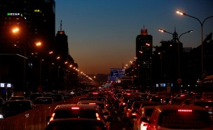 Cars stand bumper to bumper in the evening rush hour traffic jam in central Beijing, China
