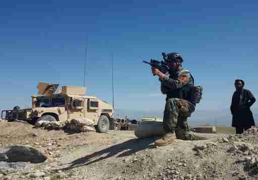 DATE IMPORTED:April 14, 2017A member of AfghanistanÕs special forces point his gun as he observes the enemy lines in Achin district of Nangarhar province, in eastern Afghanistan April 14, 2017. REUTERS/Parwiz