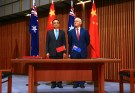 Australia's Prime Minister Malcolm Turnbull stands with Chinese Premier Li Keqiang before the start of an official signing ceremony at Parliament House in Canberra, Australia, March 24, 2017. REUTERS/David Gray
