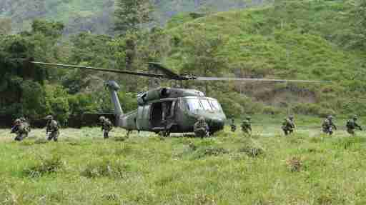 DATE IMPORTED:February 05, 2017Soldiers of the Colombian army disembark from a helicopter in a zone previously occupied by FARC rebels, in Saiza, Colombia February 3, 2017. Picture taken February 3, 2017. REUTERS/Luis Jaime Acosta