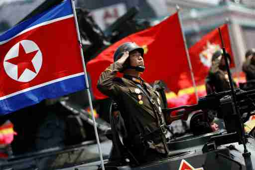 A soldier salutes from atop an armoured vehicle as it drives past the stand with North Korean leader Kim Jong Un during a military parade marking the 105th birth anniversary of country's founding father Kim Il Sung, in Pyongyang April 15, 2017. REUTERS/Damir Sagolj