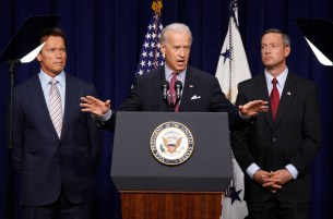 U.S. Vice President Joe Biden discusses the American Recovery and Reinvestment Act to an audience alongside California Governor Arnold Schwarzenegger (L) and Maryland Governor Martin O'Malley in the Eisenhower Executive Office building in Washington
