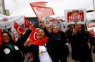 """Hayir"", ""No"" in English, supporters hold Turkish flags and leaflets for the upcoming referendum at a campaign point in Istanbul, Turkey, March 31, 2017. Picture taken March 31, 2017. REUTERS/Murad Sezer - RTX354XR"