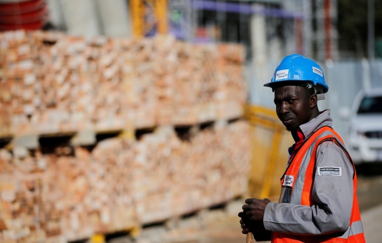A worker looks on at a construction site in Sandton, north of Johannesburg