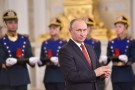 Russian President Vladimir Putin applauds during the State Prize