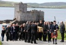 Roddy MacLeod father of Manchester bomb victim Eilidh MacLeod leads the funeral procession as it passes Kisimul Castle on its way to the Church of Our Lady, Star of the Sea, ahead of the funeral of Manchester bomb victim Eilidh MacLeod, in Castlebay on the island of Barra, in Scotland June 5, 2017. REUTERS/Andrew Milligan/Pool