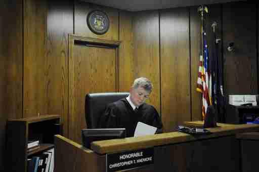 Judge Christopher Haenicke fills out paperwork
