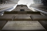 The corner stone of the New York Federal Reserve Bank is seen surrounded by financial institutions in New York City.