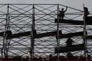 Workers dismantle scaffolding at the Hudson Yards construction project is pictured in the Manhattan borough of New York City, New York, U.S. May 24, 2017.   REUTERS/Carlo Allegri - RTX37GAX