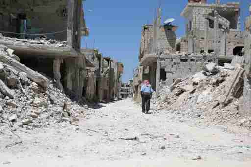 A man walks inside a former Palestinian refugee camp in a rebel-held part of the southern city of Deraa, Syria August 6, 2017. REUTERS/Alaa al-Faqir - RTS1AMVG