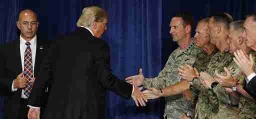 U.S. President Donald Trump shakes hands with military officers as he departs after announcing his strategy for the war in Afghanistan during an address to the nation from Fort Myer, Virginia, U.S., August 21, 2017. REUTERS/Joshua Roberts - RTS1CQRT