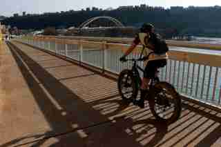 A cyclist on the Fort Duquense Bridge in downtown Pittsburgh. Gene J. Puskar/AP