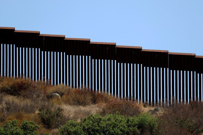 The U.S. Mexico border fence is shown looking south from Tecate, California, U.S., September 15, 2017. REUTERS/Mike Blake - RC1ABD787380