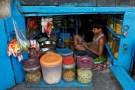 A boy uses a mobile phone as he sits inside his father's snacks shop along a road in Kolkata, India, February 22, 2016. REUTERS/Rupak De Chowdhuri/File Photo - S1BETGKJZVAA